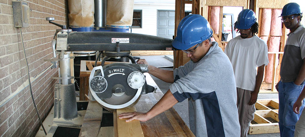Carpentry student using table saw