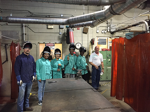 2016 MAGIC Camp participants are pictured learning about CGTC's Welding program on the Macon campus.
