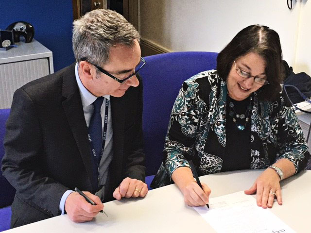 Professor Robert Aitken, the Academic Deputy vice chancellor for York St John University and Dr. Amy Holloway, vice president of Academic Affairs at CGTC, sign the Memorandum of Agreement (MOU) which could see CGTC students earn higher-level degrees in Great Britain.