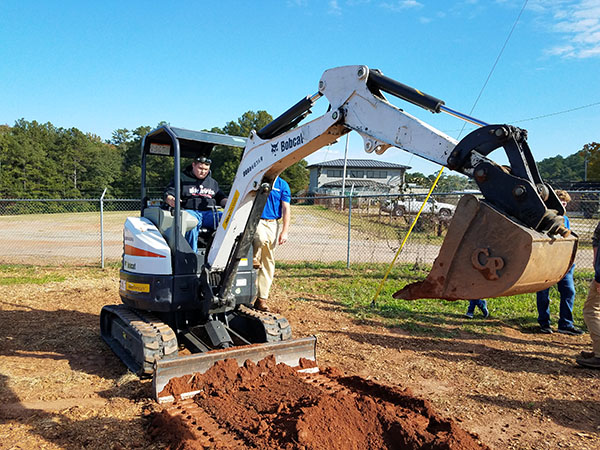 Baldwin High School and CGTC Dual Enrollment Student, Johnny Parker, operates an excavator during an exhibit at the Central Georgia and Southern Crescent Workforce Development Alliances' second annual Skills Challenge in early November.