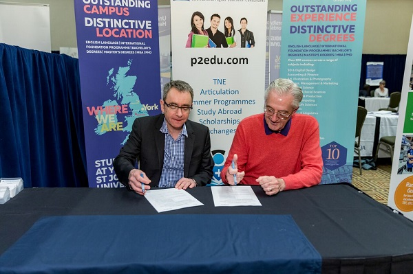 Professor Rob Aitken deputy vice chancellor, Research and International, at York St. John University, and Rick Hutto, executive director for Global Initiatives at CGTC sign an articulation agreement during the Community Colleges for International Development conference in February.
