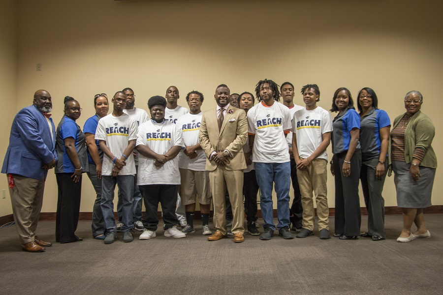 REACH program students and mentors gather with Dr. Vernard Hodges (center).