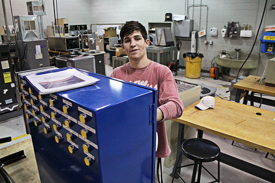 Adam Brooks, CGTC's first-ever High School Postsecondary Graduation Option graduate works in the Air Conditioning Technology lab on the Macon Campus.
