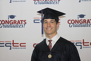 Adam Brooks graduates from CGTC. He is the College's first-ever High School Postsecondary Option graduate.
