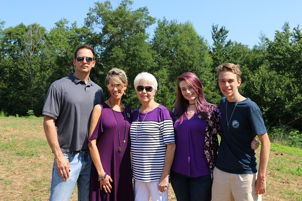 [Photo] The family of Parker Killian Moore gathers following a ribbon cutting for a trail named in Moore's honor in Warner Robins. The family of his mother, Leah Heaton Maas, raised funds following his shooting death at Barberitos restaurant on Watson Boulevard in January and is now giving back through scholarships in his honor.