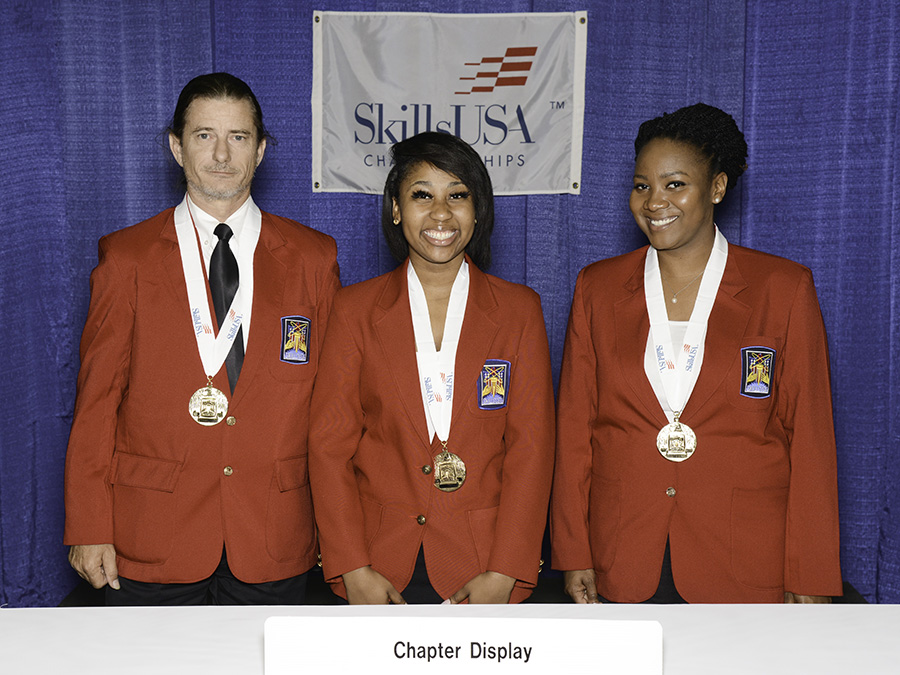 First place winners from CGTC's SkillsUSA organization celebrate their first place victory in the Chapter Display category of the SkillsUSA Nationals in Louisville, Ky., in June. (From left to right) Thomas Butler, QaNeshia Mays, and Alison Crumb show off their gold medals following the awards ceremony.