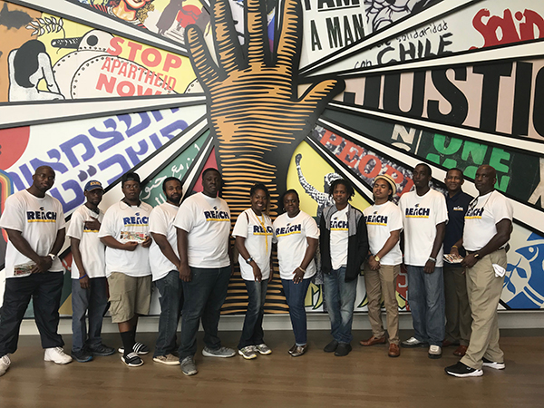 REACH program students and mentors at the Civil and Human Rights Museum