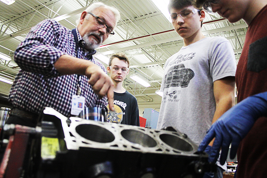 CGTC Automotive Technology instructor, George Rosenblad (left) explains techniques for the repair of a piston to his Dual Enrollment students (from left to right) Tristan Weddington, Joseph Lopez, and Chance Schooley, in the automotive lab at Houston County Career Academy.