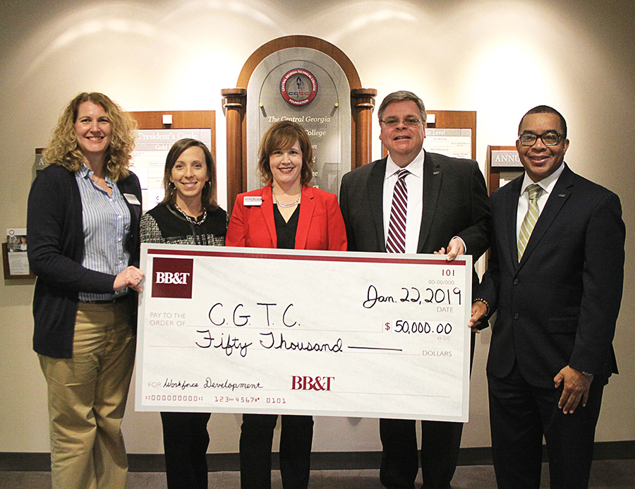 (From left to right) CGTC's vice president for Administrative Services, Dr. Michelle Siniard, vice president for Economic Development, Andrea Griner, and assistant vice president for Advancement, Tonya McClure, receive a check on behalf of the College's Foundation from BB&T representatives, Scott Seigel, market president, and, community development specialist, Derold B. Mciver.