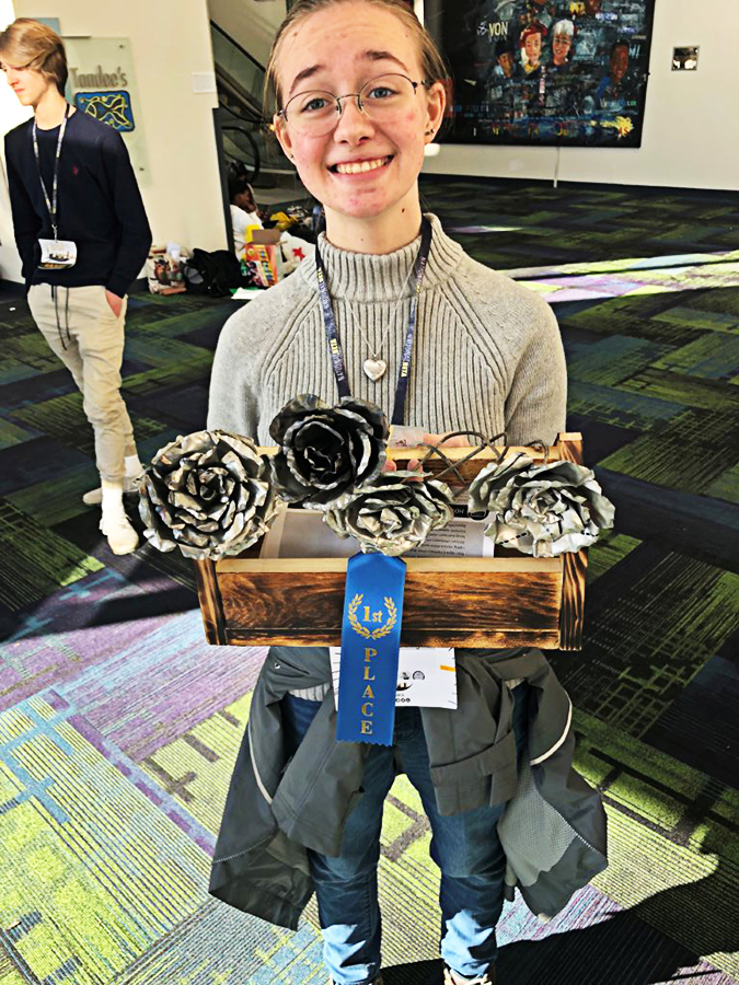 Annabell Sapp shows off her metal roses that earned her 1st place in the 80th Annual Senior Beta Convention in January.