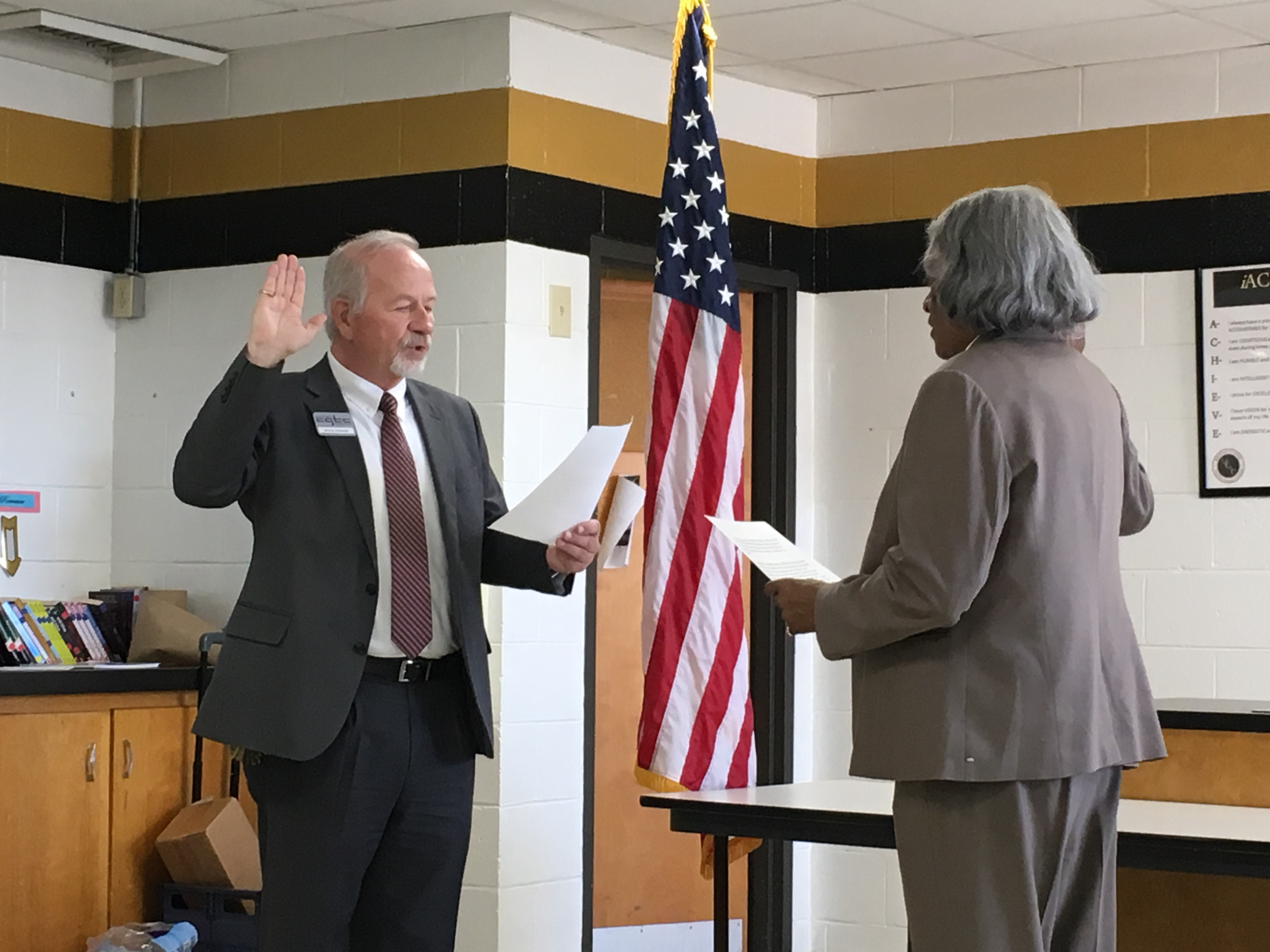 Assistant vice president of Facilities and Ancillary Services at CGTC, James Faircloth, swears in Rev. Dr. Avis Williams during the College's February Board of Directors meeting.