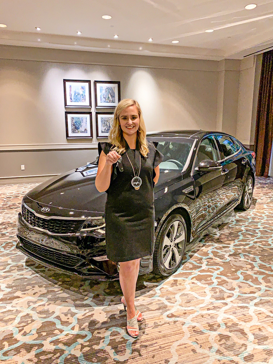 Heather Williamson holds the keys to a brand new KIA Optima, the grand prize for her award as the state's top technical college student.