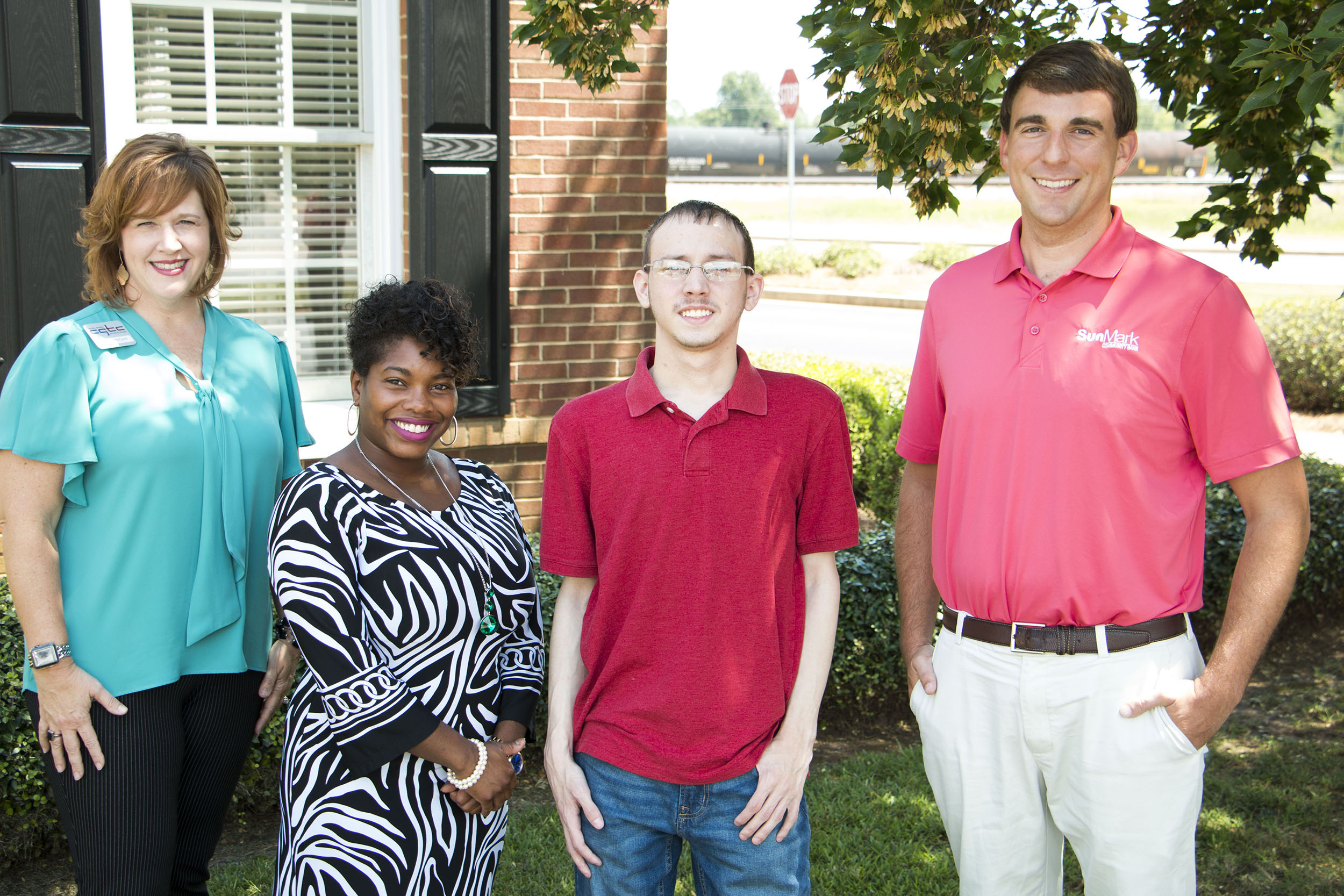 Tonya McClure, assistant vice president for Advancement at CGTC, and Carmen Davis, CGTC advancement specialist, join Austin James Smith an upcoming first-year student at the College as he receives recognition from Andrew Taunton, SunMark Community Bank Commercial Lender, Fort Valley Branch.