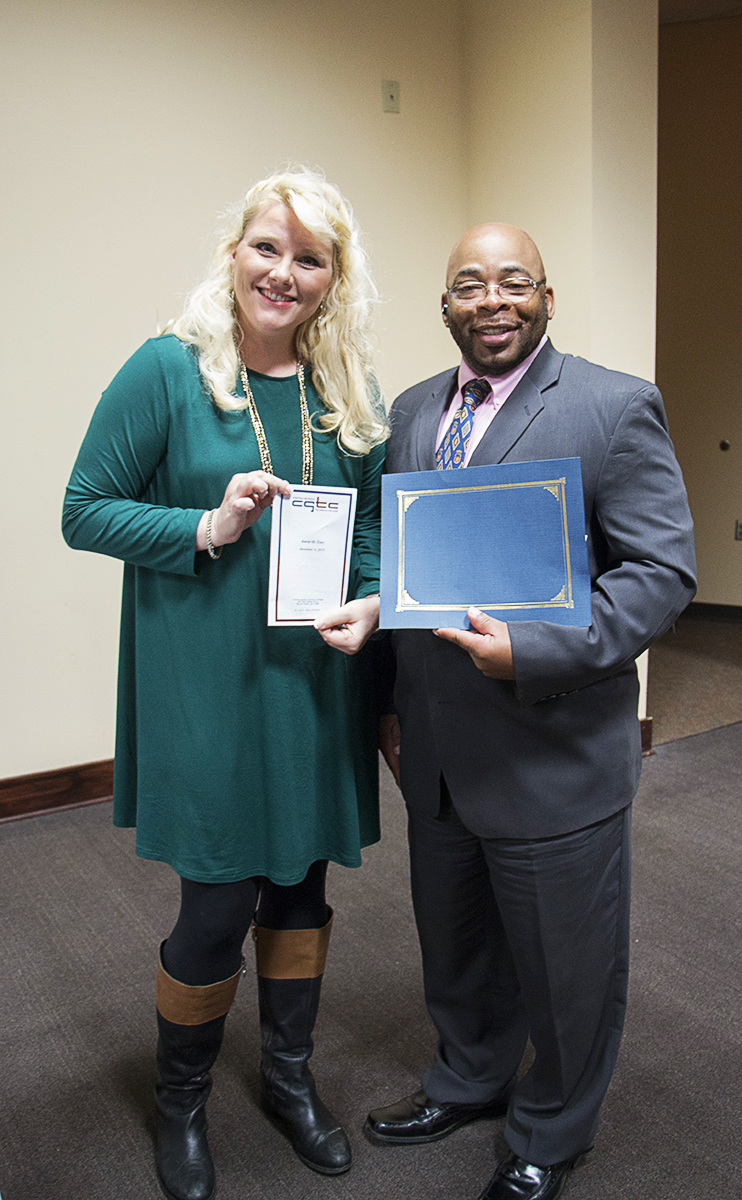 Ronald Greene receives recognition during CGTC's Awards Day, as fall 2019 RESET Scholarship recipient alongside, Dr. Brittany Lucas, executive director for the Office of Re-entry Services.