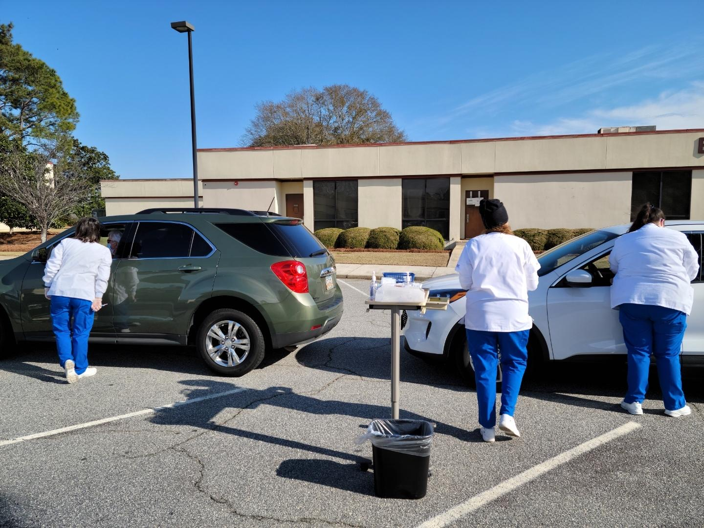 Three RN students help register and administer the Moderna COVID-19 vaccine during Taylor Regional Hospital's drive-thru clinic on January 13.