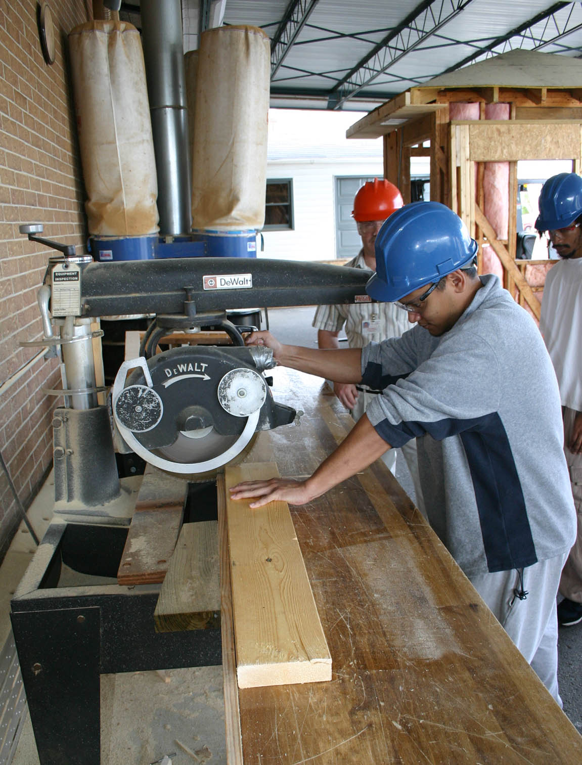CGTC Student uses saw in construction lab